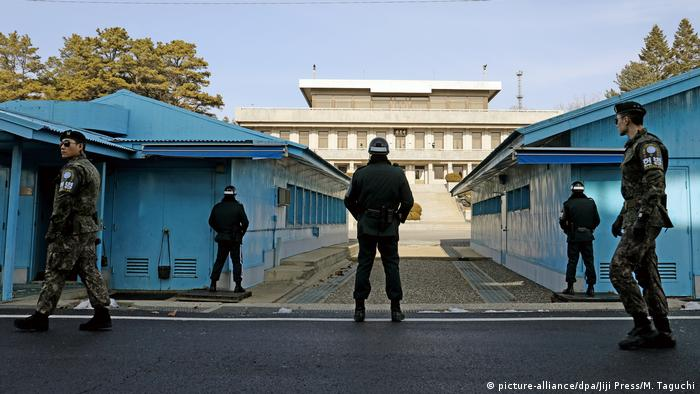 South Korean guards stand near the UN Command Military Armistice Commission conference buildings, in front of Panmon Hall, a building on the North Korean side of the border.
