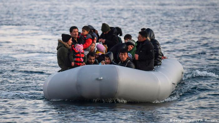 Refugees and migrants aboard an inflatable boat