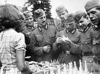 German troops surround souvenir stand in Paris, October 1940