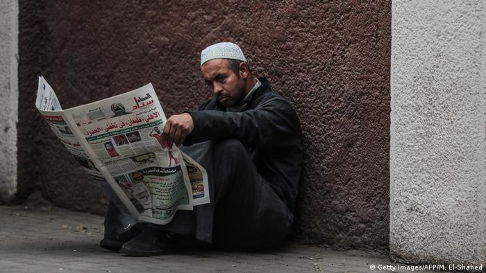 Man reads text in Cairo
