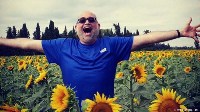 Paul Iarrobino in a field of sunflowers