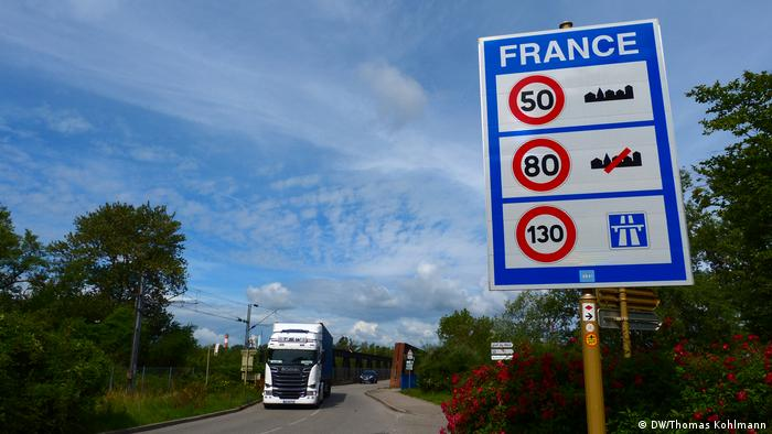 A truck can be seen crossing the border to France