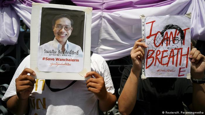 Activists hold up pictures of abducted Thai activist Wanchalearm Satsaksit as people gather in support of him during a protest calling for an investigation, in front of the Government house in Bangkok