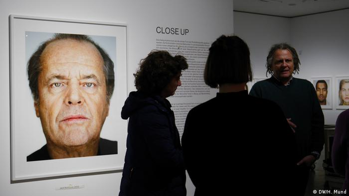 Martin Schoeller at 'Close Up' exhibition with a portrait of Jack Nicholson