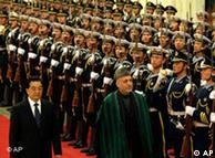 Presidents Hu Jintao and Hamid Karzai inspect the honor guards in Beijing