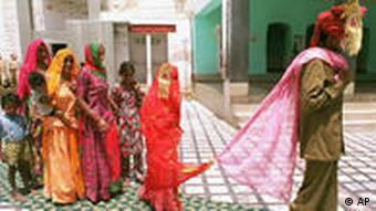 Mina, 8, center, follows her new husband as she visits a temple with Sukhram, 22, right, and his family members Wednesday April 22, 1998 in Bikaner, India, after their marriage..(AP Photo/Saurabh Das)