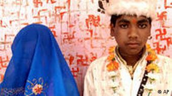 Soram Bai, 11, and her groom Bheeram Singh, 16, stand pose for photographs at the Jalpa Mata Temple after their marriage ceremony in Rajgarh district, about 155 kilometers (96 miles), northeast of Bhopal, India, (AP Photo/Prakash Hatvalne)