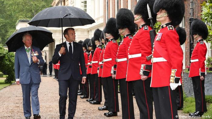 Prince Charles, Prince of Wales and French President Emmanuel Macron inspect the Grenadier Guards at Clarence House