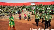 Supporters of Burundi's President elect Evariste Ndayishimiye attend his inauguration ceremony following the sudden death of his predecessor Pierre Nkurunziza, amid the growing threat of the coronavirus disease (COVID-19), at the Ingoma stadium in Gitega, Burundi June 18, 2020. REUTERS/Evrard Ngendakumana TPX IMAGES OF THE DAY