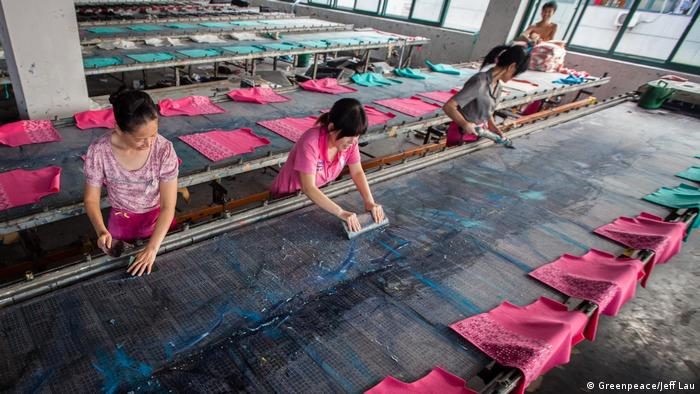Three female workers in a textile factory in China (Greenpeace/Jeff Lau)
