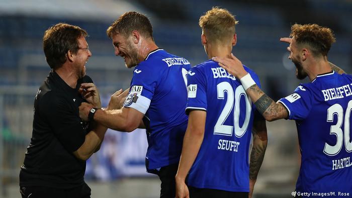 Fabian Klos of Bielefeld celebrates scoring his team's third goal with Rainer Schonz during the Second Bundesliga match between DSC Arminia Bielefeld and SG Dynamo Dresden