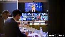 European leaders are broadcasted on a screen as they attend a virtual meeting to discuss the bloc's budget and recovery fund, in Paris, France June 19, 2020. Eliot Blondet/Pool via REUTERS