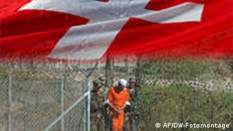 FILE - In this March 1, 2002 file photo, a detainee is escorted to interrogation by U.S. military guards at Camp X-Ray at Guantanamo Bay U.S. Naval Base, Cuba. Three detainees from Guantanamo Bay have been transferred from the island prison to the country of Georgia. The Justice Department says the identities of the three detainees sent to Georgia on Tuesday March 23, 2010, are being withheld for security and privacy reasons. (AP Photo/Andres Leighton, File)