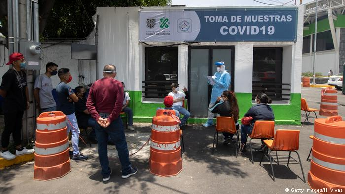 A doctor gives instructions on how to test for COVID-19 at Central de Abastos on June 19 (Getty Images/H. Vivas)