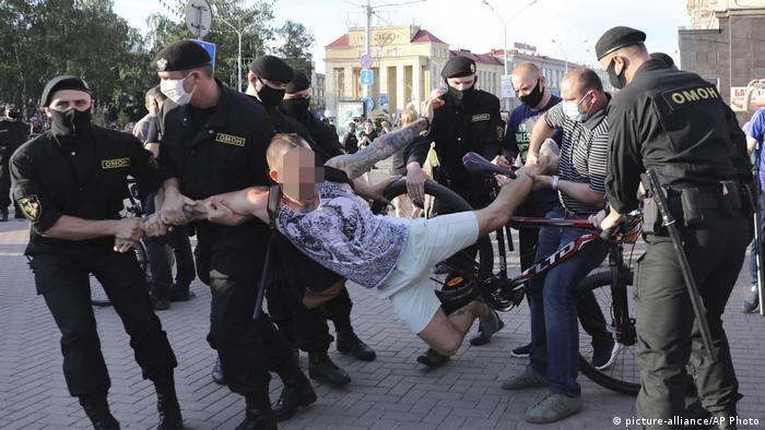 Belarus police arrest protestors at a Minsk rally