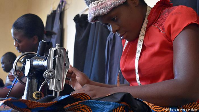 A woman uses a sewing machine