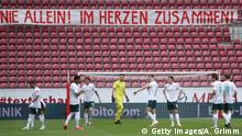 MAINZ, GERMANY - JUNE 20: The players of Bremen stand under banner reading not alone together in the heart during the Bundesliga match between 1. FSV Mainz 05 and SV Werder Bremen at Opel Arena on June 20, 2020 in Mainz, Germany. (Photo by Alex Grimm/Getty Images)
