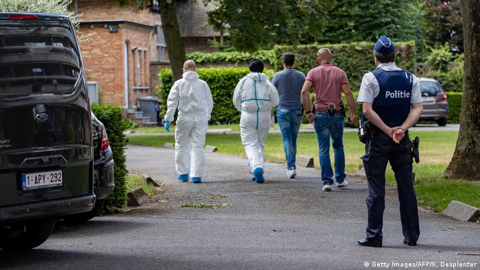 Police and forensics arrive at De Fauw's house