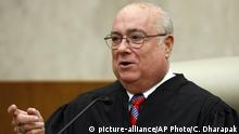 FILE - In this May 1, 2008 file photo, U.S. District Judge Royce C. Lamberth is seen during a ceremony at the federal courthouse in Washington. Lamberth has ruled, Saturday, June 20, 2020, that former national security adviser John Bolton can move forward in publishing his tell-all book. The Trump administration had tried to block the release because of concerns that classified information could be exposed.(AP Photo/Charles Dharapak, File)  