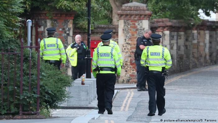 Police roam the scene of the stabbing in Reading