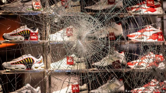 A cracked window in front of a shoe store in Stuttgart