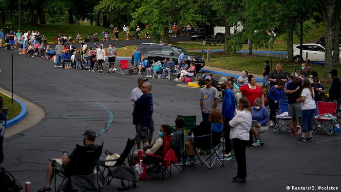 People line up outside Kentucky Career Center in Frankfort on June 18 to find assistance with their unemployment claims
