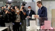 Serbian President Aleksandar Vucic casts a ballot during a national election, the first in Europe since coronavirus lockdown, at a polling station in Belgrade, Serbia, June 21, 2020. REUTERS/Marko Djurica