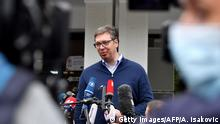 Serbian President Aleksandar Vucic addresses the media outside a polling station in Belgrade on June 21, 2020 during an election for a new parliament in Europe's first national election since the coronavirus pandemic, though few expect major surprises with the ruling party poised to dominate a scattered opposition, some of whom are boycotting the ballot. (Photo by ANDREJ ISAKOVIC / AFP) (Photo by ANDREJ ISAKOVIC/AFP via Getty Images)