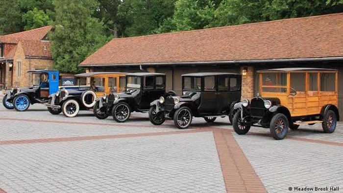An array of Dodge Brothers vehicles to mark the company's 100th anniversary in 2014. From left: A 1919 Graham Brothers truck (built with a Dodge chassis), a 1927 Dodge depot hack, a 1947 Dodge truck, a 1915 Dodge touring car and a 1925 Dodge depot hack - Meadow Brook Hall