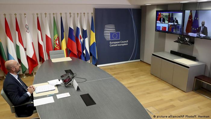 uropean Council President Charles Michel, left, speaks with Chinese Premier Li Keqiang, on screen, during an EU-China summit, in video conference format, at the European Council in Brussels
