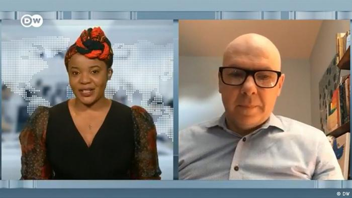 Screenshot from DW television showing DW host Mimi Mefo and Dr. Simon Adams