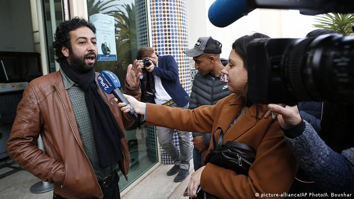 Omar Radi speaks to the media after a hearing at the Casablanca Courthouse in March 2020