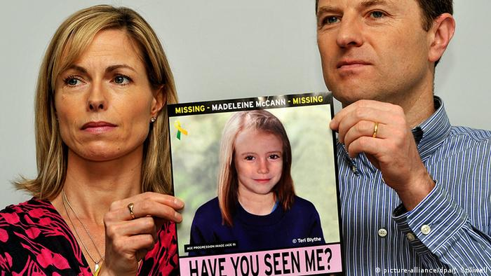 Madeleine McCann's parents hold up her picture