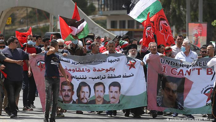 A group of Palestinians gather to protest the Israel's annexation plan of the Jordan Valley