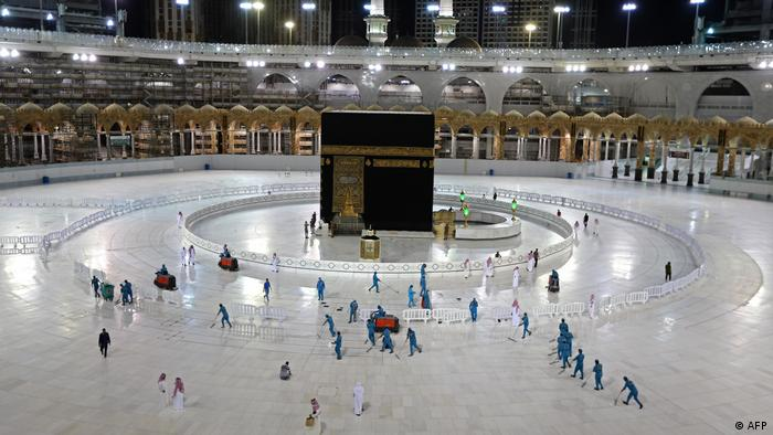 Sanitation workers disinfect the area around the Kaaba in Mecca's Grand Mosque, on the first day of the Islamic holy month of Ramadan