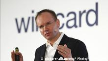 FILE - In this Thursday, April 25, 2019 file photo, Markus Braun, CEO of financial services company wirecard, attends the earnings press conference in Munich, Germany. Prosecutors in Germany say that the former CEO of the payments company Wirecard has been arrested in an accounting scandal that centers on a missing sum of 1.9 billion euros, or 2.1 billion dollars. Markus Braun resigned on Friday after the company disclosed that auditors couldn't find accounts containing the money.(AP Photo/Matthias Schrader, file) |