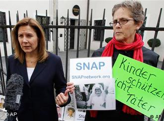 Barbara Blaine, left, president of the Survivors Network of those Abused by Priests, and Barbara Dorris protest in front of the diocesan authorities headquarter in Munich, southern Germany, on Monday, March 22.
