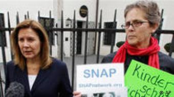 Barbara Blaine, left, president of the Survivors Network of those Abused by Priests, and Barbara Dorris protest in front of the diocesan authorities headquarter in Munich