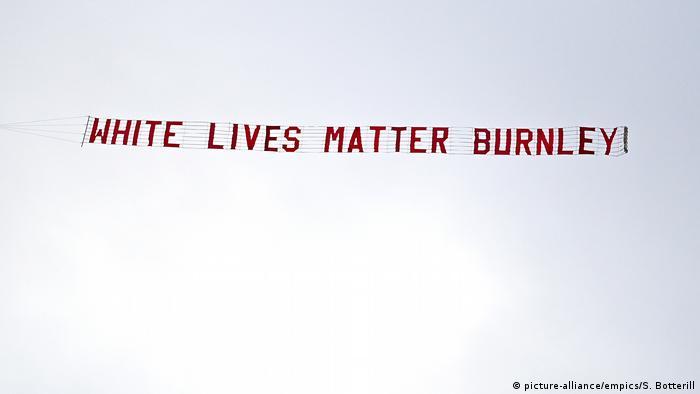 The White Lives Matter banner flies over the Etihad Stadium