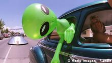 372049 02: An alien doll hangs out a car window in downtown Roswell, New Mexico July 1, 2000 as part of the annual UFO Encounter, which runs through July 4, 2000. The annual festival stems from a mysterious crash northwest of Roswell in 1947. The Army initially said it was a UFO crash, but quickly backed off that report. The Pentagon has since said it was a top-secret balloon crash, but UFO enthusiasts don''t believe that story, which gives rise to what has become known as the Roswell Incident. (Photo by Joe Raedle/Newsmakers)