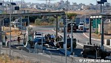 Israeli security forces gather at the site of a reported ramming attack at a checkpoint in the occupied West Bank near the village of Abu Dis on June 23, 2020. - A Palestinian man was shot dead at a checkpoint in the occupied West Bank after driving his car quickly towards a border officer, Israeli police said. (Photo by Musa Al SHAER / AFP)