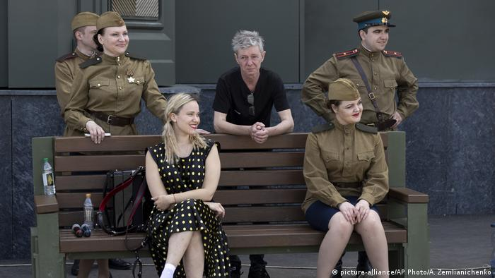 Artists wearing WWII-era uniforms pause waiting for a concert at the newly-built main cathedral of the Russian military in the Patriot Park outside in Moscow, Russia, Tuesday, June 23, 2020.