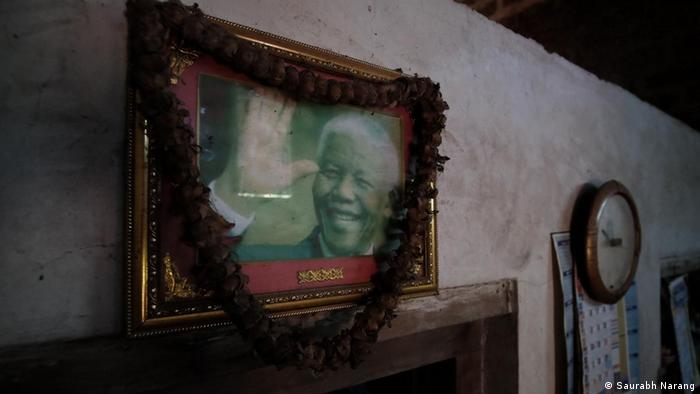 A framed photo of Nelson Mandela — South-Africa's first Black head of state and anti-apartheid revolutionary — hangs in the home of a Siddi family in Talikumbri village, Karnataka.