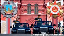 Russian Defence Minister Sergei Shoigu salutes to soldiers as he is driven along Red Square during a military parade, which marks the 75th anniversary of the Soviet victory over Nazi Germany in World War Two, in Moscow on June 24, 2020. - The parade, usually held on May 9, was postponed this year because of the coronavirus pandemic. (Photo by Alexander NEMENOV / AFP) (Photo by ALEXANDER NEMENOV/AFP via Getty Images)