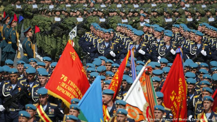 Russian soldiers march in formation as they head to Red Square for a Victory Day military parade