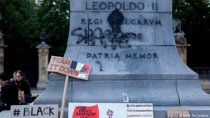 BLM flags and placards on the steps of a King Leopold II statue in Brussels