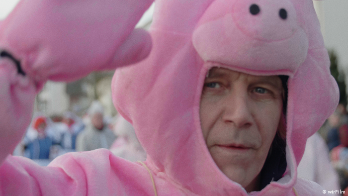 man in a pink pig costume
