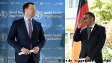 German Health Minister Jens Spahn (L) stand next to World Health Organization (WHO) Director-General Tedros Adhanom Ghebreyesus as they listen to a press conference following a meeting about the COVID-19 outbreak, caused by the novel coronavirus, at the World Health Organization headquarters in Geneva, on June 25, 2020. (Photo by Fabrice COFFRINI / AFP) (Photo by FABRICE COFFRINI/AFP via Getty Images)