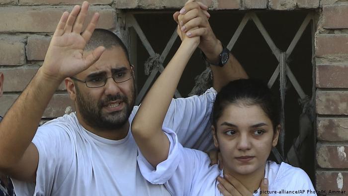 Egyptian blogger Alaa Abdel-Fattah with his sister Sanaa Seif addressing a rally