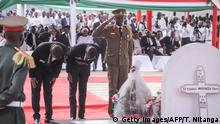 The sons of late Burundi President Pierre Nkurunziza, who died at the age of 55, Kelly (R), Kevin (3rd R) and Jonathan (2nd R), take a last moment of farewell in front of their father's tomb after burying the coffin during the national funeral at a public park next to the Ingoma stadium in Gitega, Burundi, on June 26, 2020. (Photo by Tchandrou NITANGA / AFP) (Photo by TCHANDROU NITANGA/AFP via Getty Images)